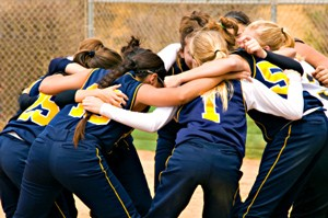 Softball Tryouts team huddle